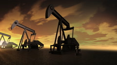 Oil industry pump. Oil donkeys producing crude oil in a desert at sunset Stock Footage
