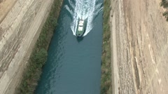Camera tracks a small boat sails along the Corinth Canal Stock Footage
