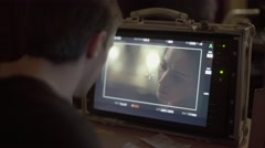The Director looks at the monitor for shooting scenes with the actress Stock Footage
