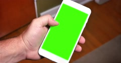 Holding Generic Green Screen Smart Phone Portrait Mode Stock Footage