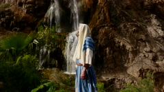 The Man in the Jewish Dress Near the Waterfall. Stock Footage