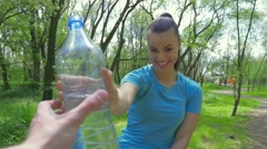 2 in 1 video. Gir drinking water after treaning and giving it to someone. Stock Footage