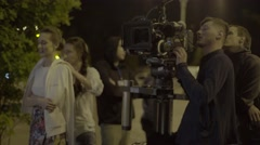 The actress plays the role in front of the cameraman in the night Stock Footage