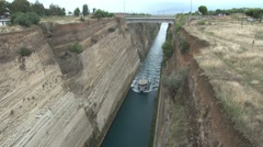 Small boat sails along the Corinth Canal Stock Footage