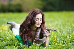 Attracrive girl with python Stock Photos