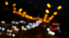 Abstract lights of traffic in the night. Blurred, not in focus, intentionally. - stock footage