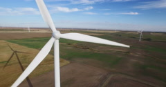 Aerial view of windmill farm on Prairies - stock footage