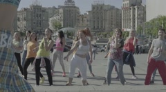 The group of people involved in the dance fitness in the town square Stock Footage