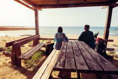 Couple of travelers on wooden veranda Stock Photos