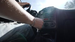 Car driving against the sun while gearing down Stock Footage