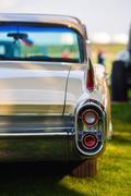 Back view of retro car - stock photo