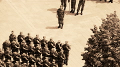 Military marching of soldiers through the town Stock Footage