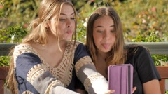 Generation z girls using a wireless tablet pc computer to take selfie photo Stock Footage