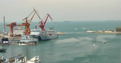 4k Industrial working crane bridge in shipyard,Ship into port,QingDao china. Stock Footage