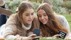 Two young woman funny expression faces at mobile phone camera technology Stock Footage