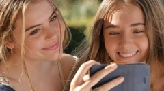 Best friends teen selfie shots with mobile phone cheerful face expression Stock Footage