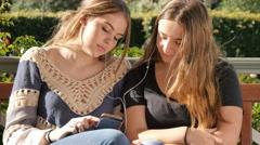 Happy best friend teenage girls listening to music together lifestyle friendship Stock Footage