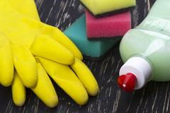 Detergent,sponges  and latex gloves Stock Photos