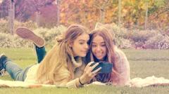 Teenage girls enjoying taking selfie on mobile smart phone technology Stock Footage