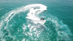 Jet skiing in open waters - Aerial footage Stock Footage