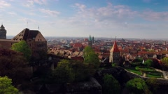 Aerial city with a castle in the foreground while pointing the tower - stock footage
