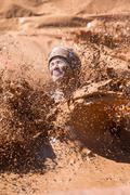 Woman Splashes Muddy Water In Dirty Girl Mud Run Stock Photos