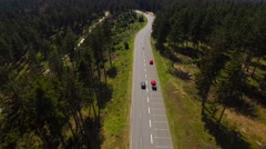 Aerial Flight Trough German Forest While Following A Car And A Bicyclist Stock Footage
