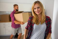 Young couple just move to their new apartment. Beautiful girl and her boyfrie - stock photo