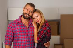 Young couple just move to their new apartment. They are still unpacked. Stock Photos