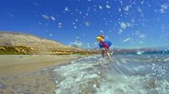 Cute Girl Swimming and Having Fun in the Sea Stock Footage