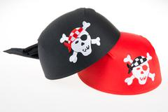 Pirate fancy hat with Jolly Roger red and black Stock Photos