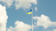 The national yellow and blue flag of Ukraine over the sky and clouds Stock Footage