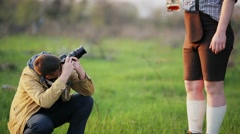 The photographer takes a picture of a man who drinks beer. - stock footage