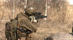 A soldier looks through the gun sight.Armed conflict. Stock Footage