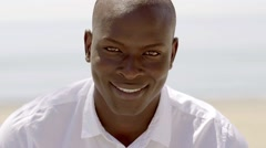 Close up of smiling black male model in white Stock Footage