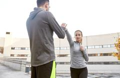 woman with trainer working out self defense strike - stock photo