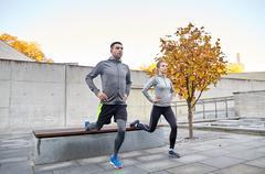 Couple doing lunge exercise on city street Kuvituskuvat