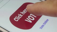 Macro CU user scrolls with finger on tablet voting app: 'Click Here to Vote' Stock Footage
