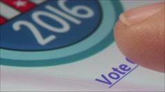 "Macro CU user's fingertip taps ""Vote Online Below' on Smartphone Stock Footage"