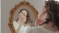 Woman combing hair near mirror Stock Footage