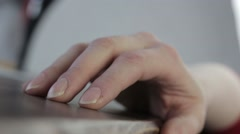 Woman strumming her fingers on a table - stock footage