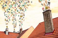 A lot of euro money flies up the chimneys Stock Photos