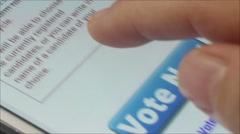Macro CU of user tapping large 'Vote Now' button on smartphone app Stock Footage