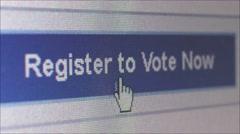 Macro CU of online voting website - user clicks 'Register to Vote' Stock Footage