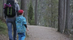 Mother and child walking on hiking trail Stock Footage