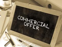 Commercial Offer Handwritten by White Chalk on a Blackboard - stock illustration
