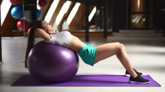 Beautiful sporty sexy woman doing workout on ball Stock Footage