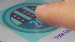 Macro CU of user pressing 2016 US election banner button on smartphone Stock Footage