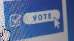Macro CU computer screen showing 'Vote' icon; user moves cursor - stock footage
