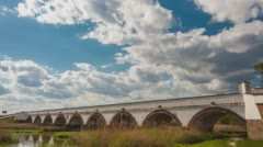 Nine-arched Bridge in Hungary, slow clouds on the blue sky Stock Footage